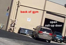 San Mateo Gymnastics back of gym, corner, and open roll-up door