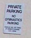 """PRIVATE PARKING NO GYMNASTICS PARKING"" sign"