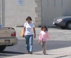 Parent and child walking on Karen Road to San Mateo Gymnastics