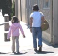 Parent and child walking to San Mateo Gymnastics on Elmer Street, Belmont, CA